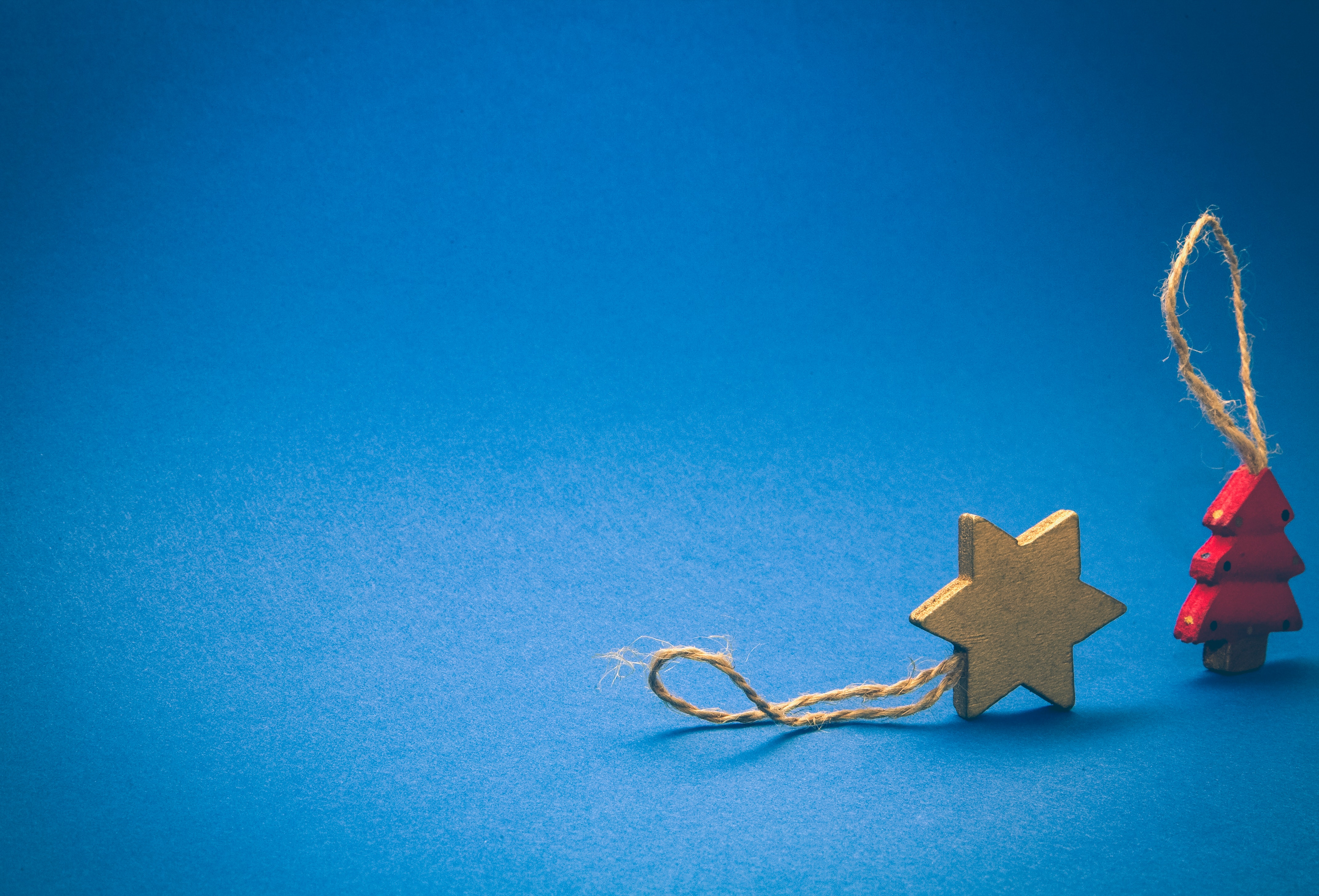 gold star of david ornament next to red christmas tree ornament