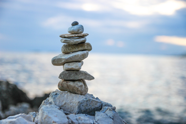 image of balancing stones on river